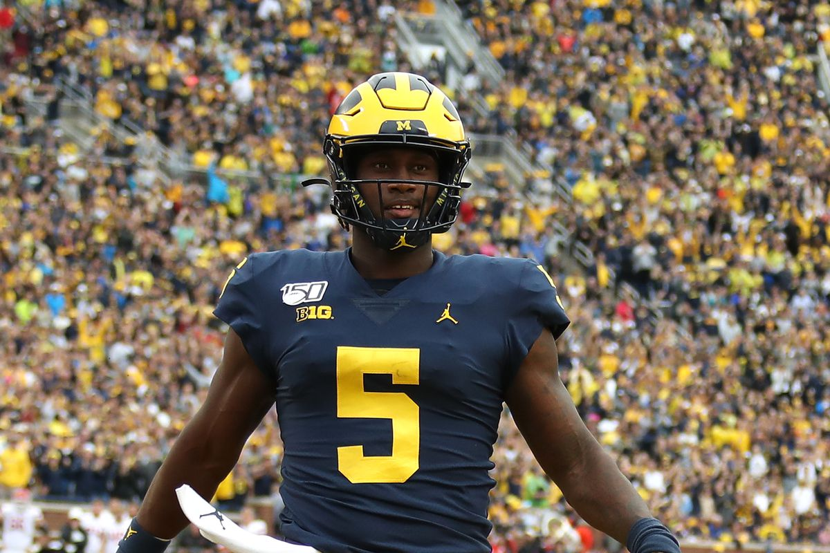 Joe Milton of the Michigan Wolverines scores a fourth quarter touchdown while playing the Rutgers Scarlet Knights at Michigan Stadium on September 28, 2019 in Ann Arbor, Michigan.