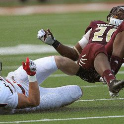 Texas Tech's Cody Davis upends Texas State's Terrence Franks during their NCAA college football game in San Marcos, Texas, Saturday, Sept. 8, 2012.