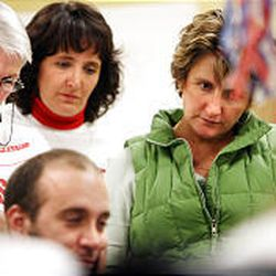 Mickey Swenson, left, Toni VanEkelenburg and Michelle Ainsworth, foes of the gravel pit proposition in Sandy, watch as numbers come in.