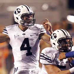Taysom Hill of the Brigham Young Cougars passes the ball against Boise during NCAA football in Boise, Thursday, Sept. 20, 2012.