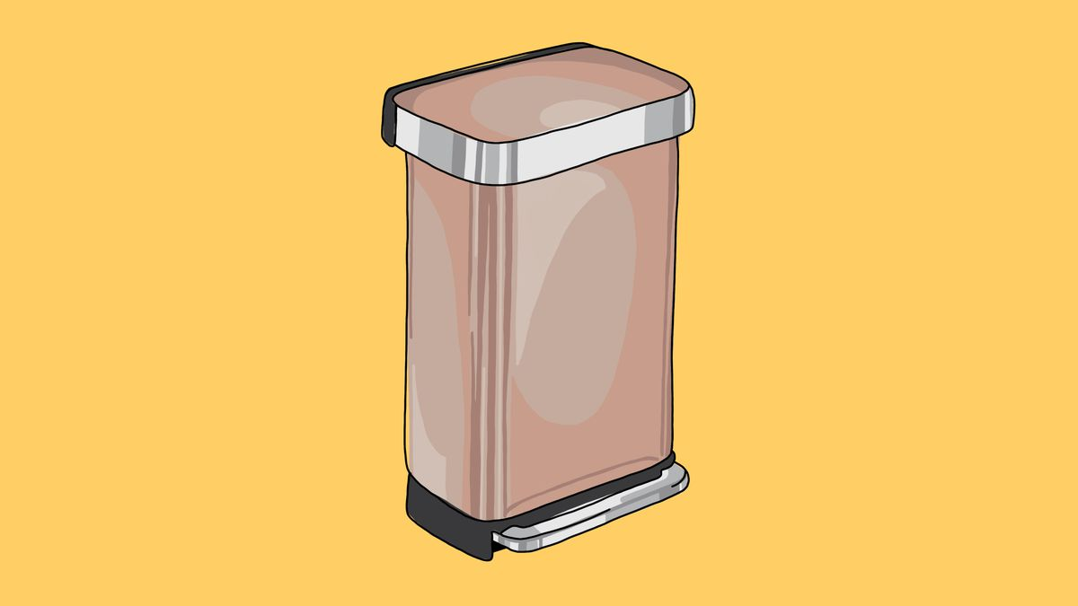 a rose gold trash can