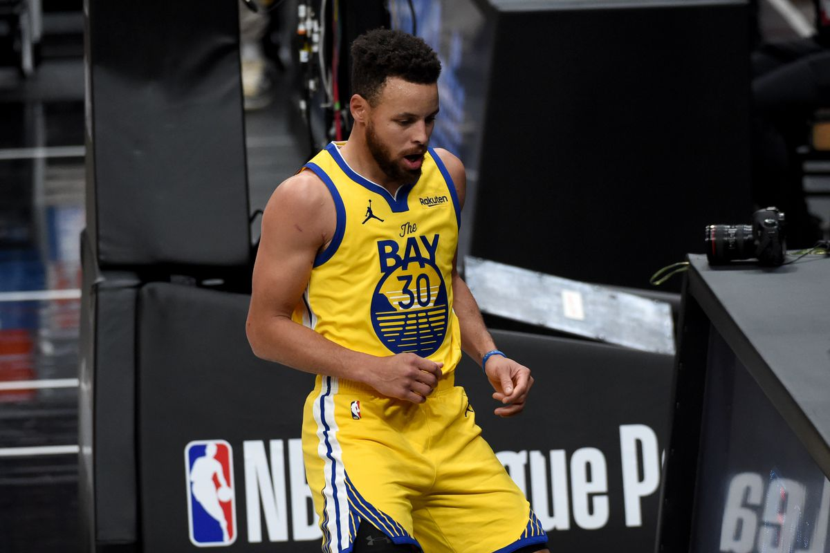 Golden State Warriors guard Stephen Curry reacts after a basket during the first half against the Portland Trail Blazers at Moda Center.