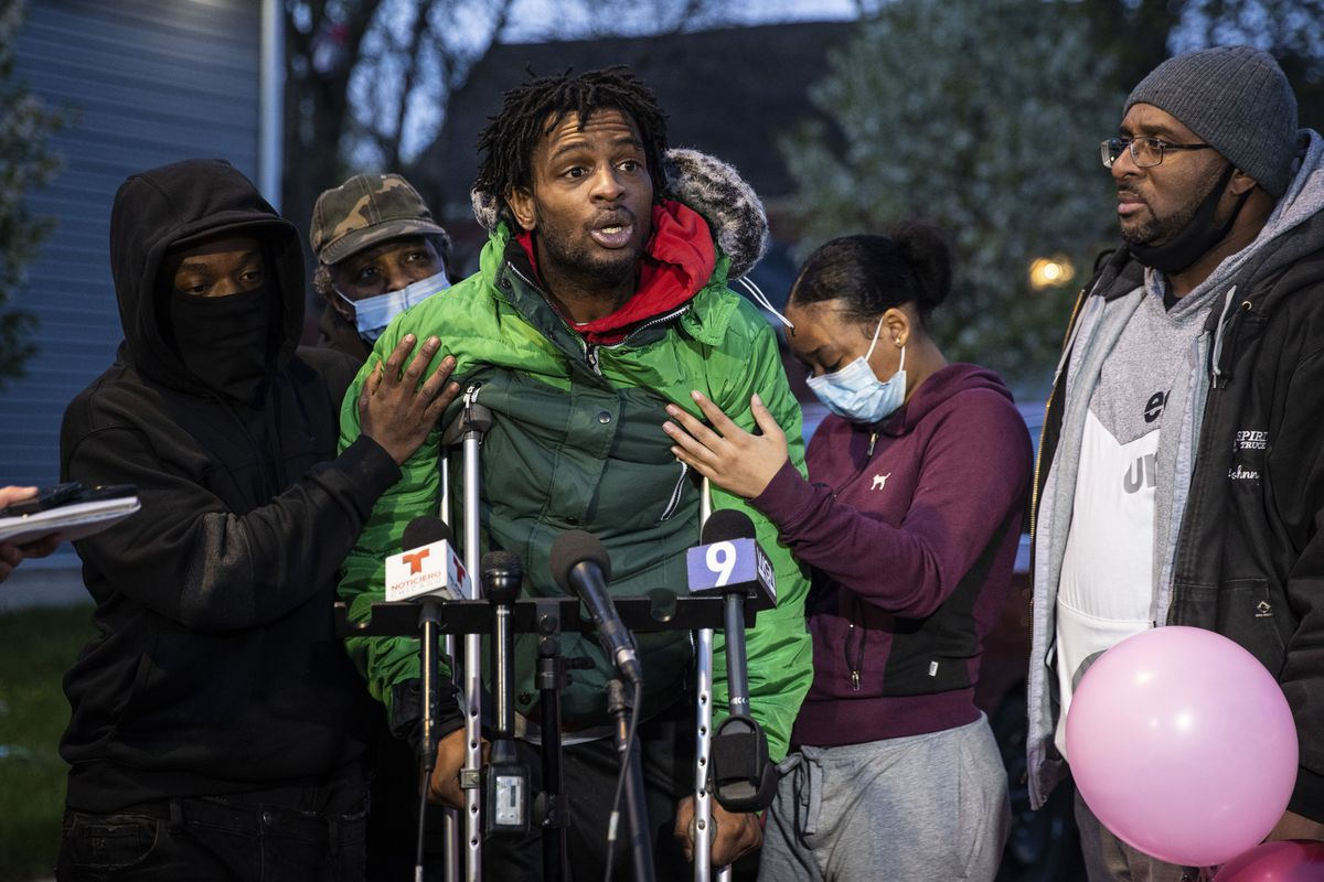 Flanked by family members and supporters who helped hold him up, Jontae Adams speaks to reporters Wednesday evening during a vigil for his 7-year-old daughter, Jaslyn Adams, outside the girl's grandmother's West Side home. Jaslyn was fatally shot Sunday while in line at a McDonald's drive-thru with her father, Jontae Adams, who suffered one gunshot wound to the back and survived. Jontae Adams was released Tuesday from Stroger Hospital.