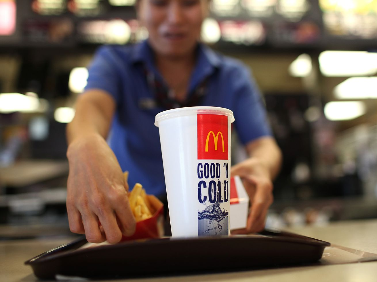 A McDonald's worker preparing an order.