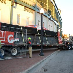 4:28 p.m. The flatbed truck starts to pull away from the ballpark -