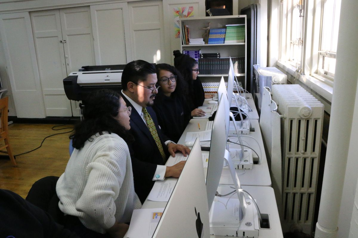 Students at Williamsburg High School of Arts and Technology teach Chancellor Richard Carranza how to code, ahead of an announcement Thursday on an expansion of CTE programs.