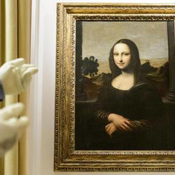 """A painting attributed to Leonardo da Vinci and representing Mona Lisa is seen during a preview presentation in a vault in Onex near Geneva, Wednesday, September 26, 2012. The Mona Lisa Foundation, a non-profit organisation based in Zurich, will present September 27, a painting and historical, comparative and scientific evidence, which demonstrate that there have always been two portraits of the Mona Lisa by Leonardo da Vinci, the """"Earlier Version"""", made 10 years earlier than the """"Joconde"""" that is displayed in Le Louvre in Paris."""