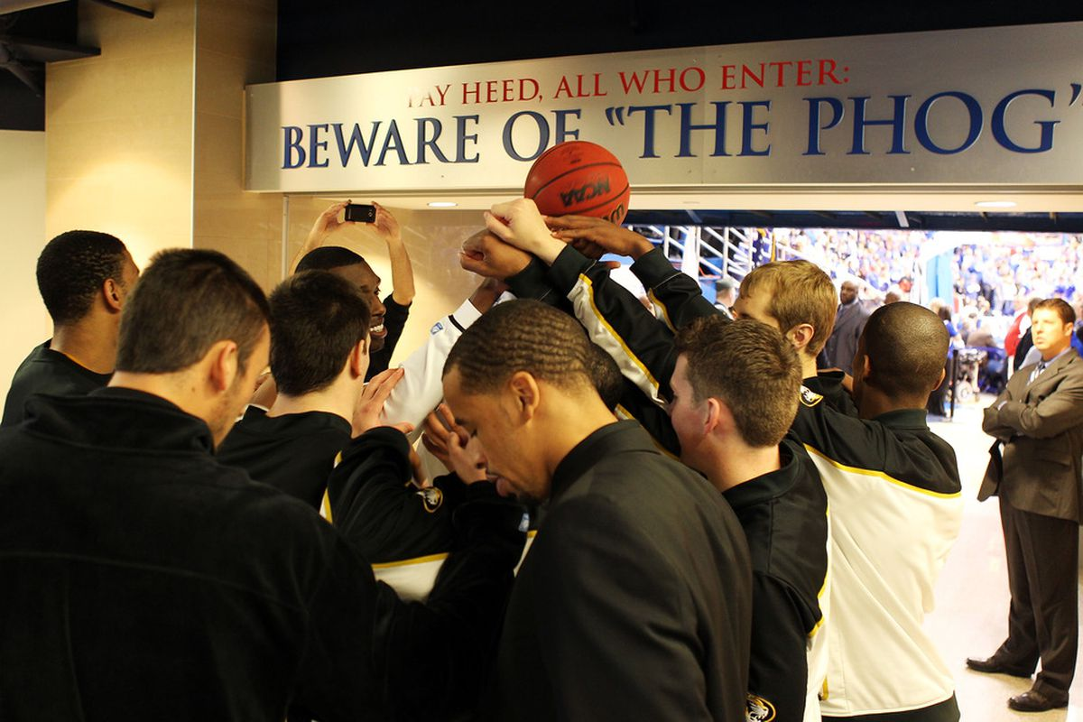 LAWRENCE, KS - FEBRUARY 25:  Missouri Tigers players pray prior to the game against the Kansas Jayhawks on February 25, 2012 at Allen Fieldhouse in Lawrence, Kansas.  (Photo by Jamie Squire/Getty Images)