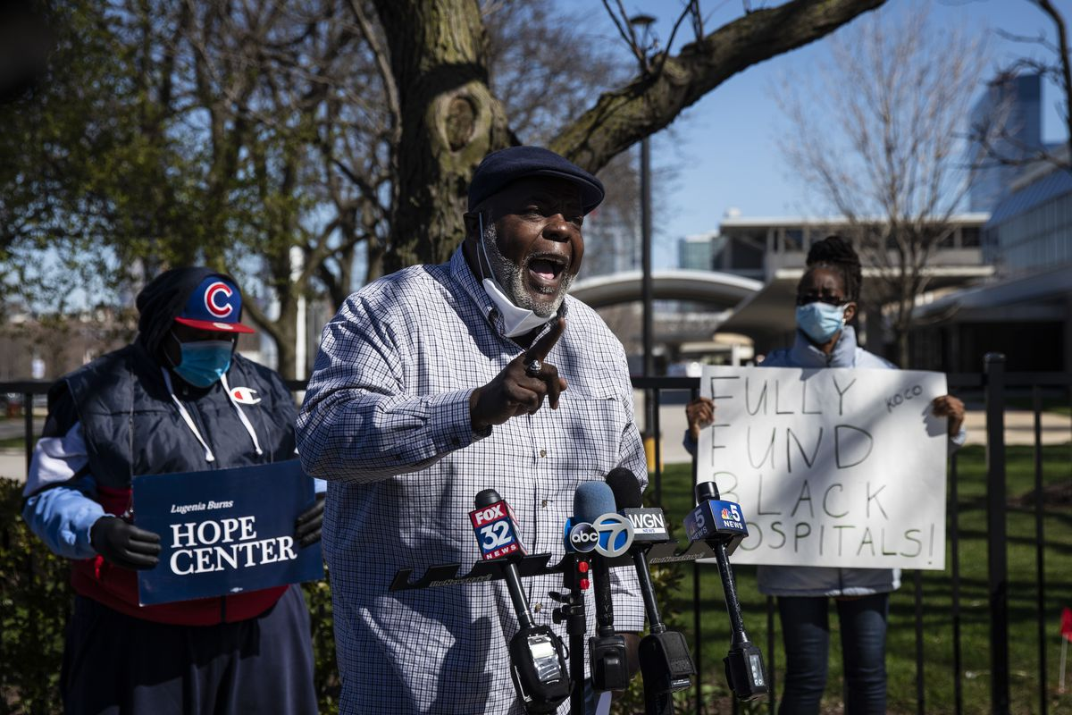Jitu Brown, of the Kenwood Oakland Community Organization and Journey for Justice Alliance, speaks to reporters outside Mercy Hospital & Medical Center on Monday, April 20, 2020.