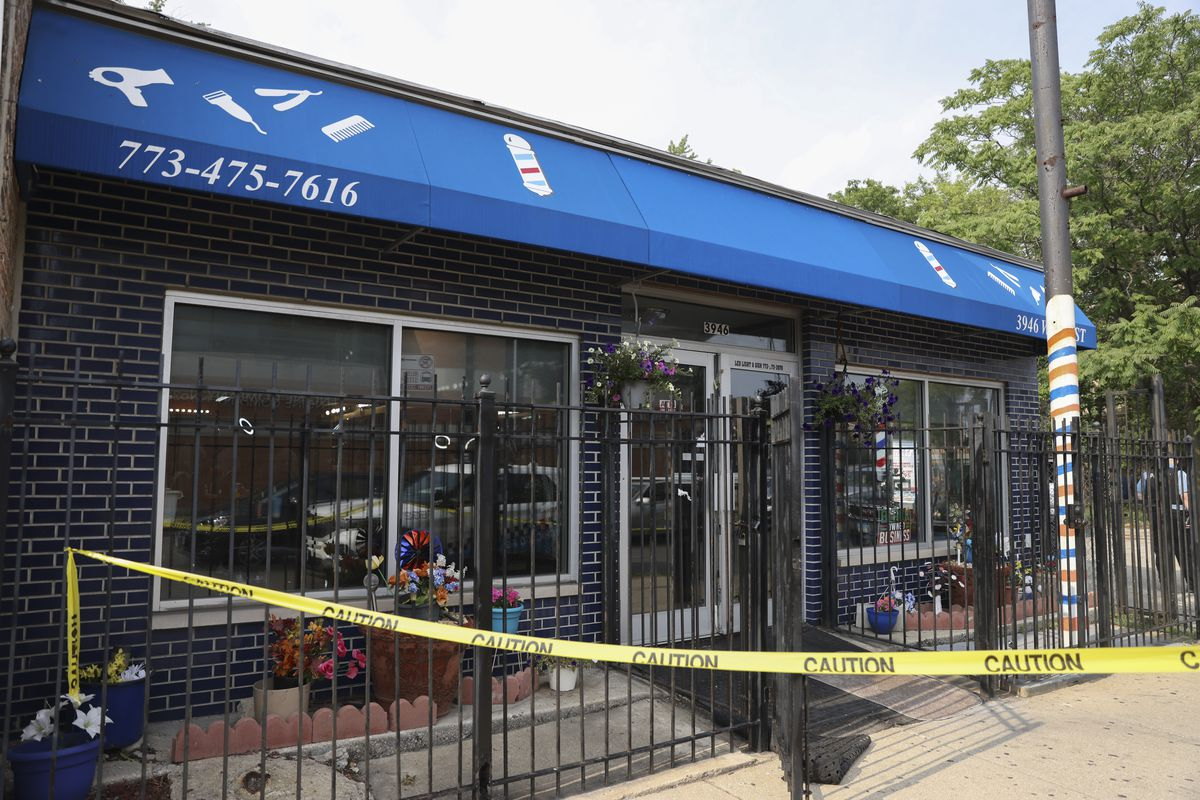 A salon is taped off in Lawndale where two men were shot, one fatally, Wednesday, July 28, 2021.