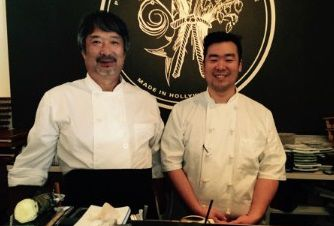 Two chefs standing behind sushi counter in Los Angeles.