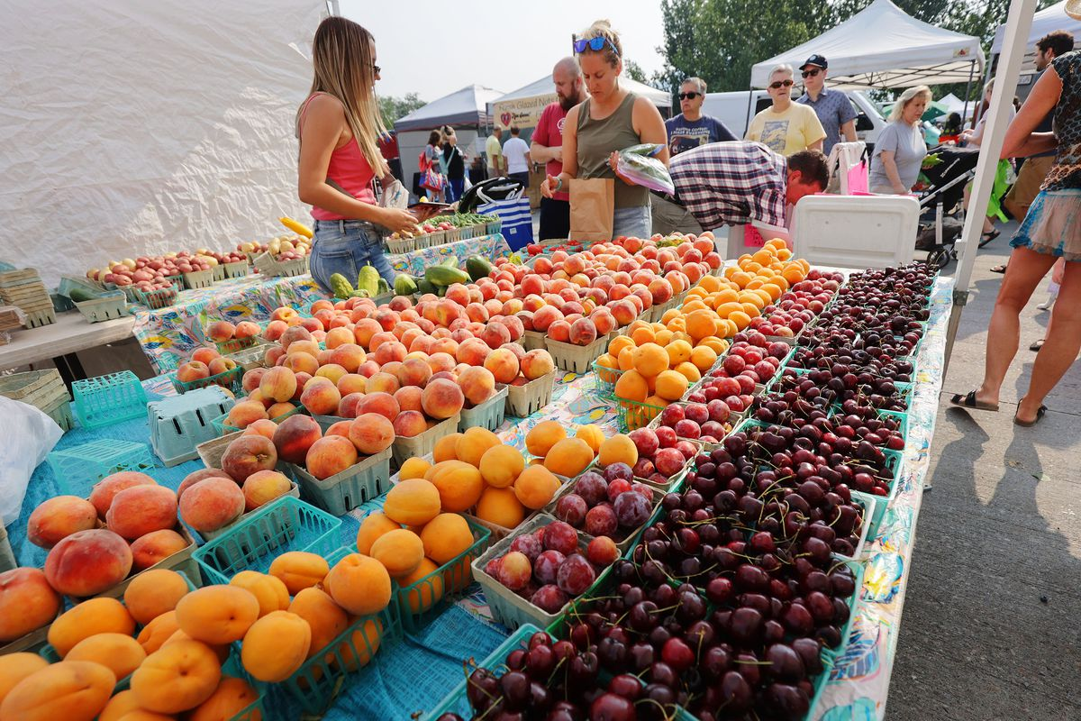 Chad's Produce sells fruit at the Wheeler Historic Farm farmers market in Murray on Sunday, July 25, 2021.