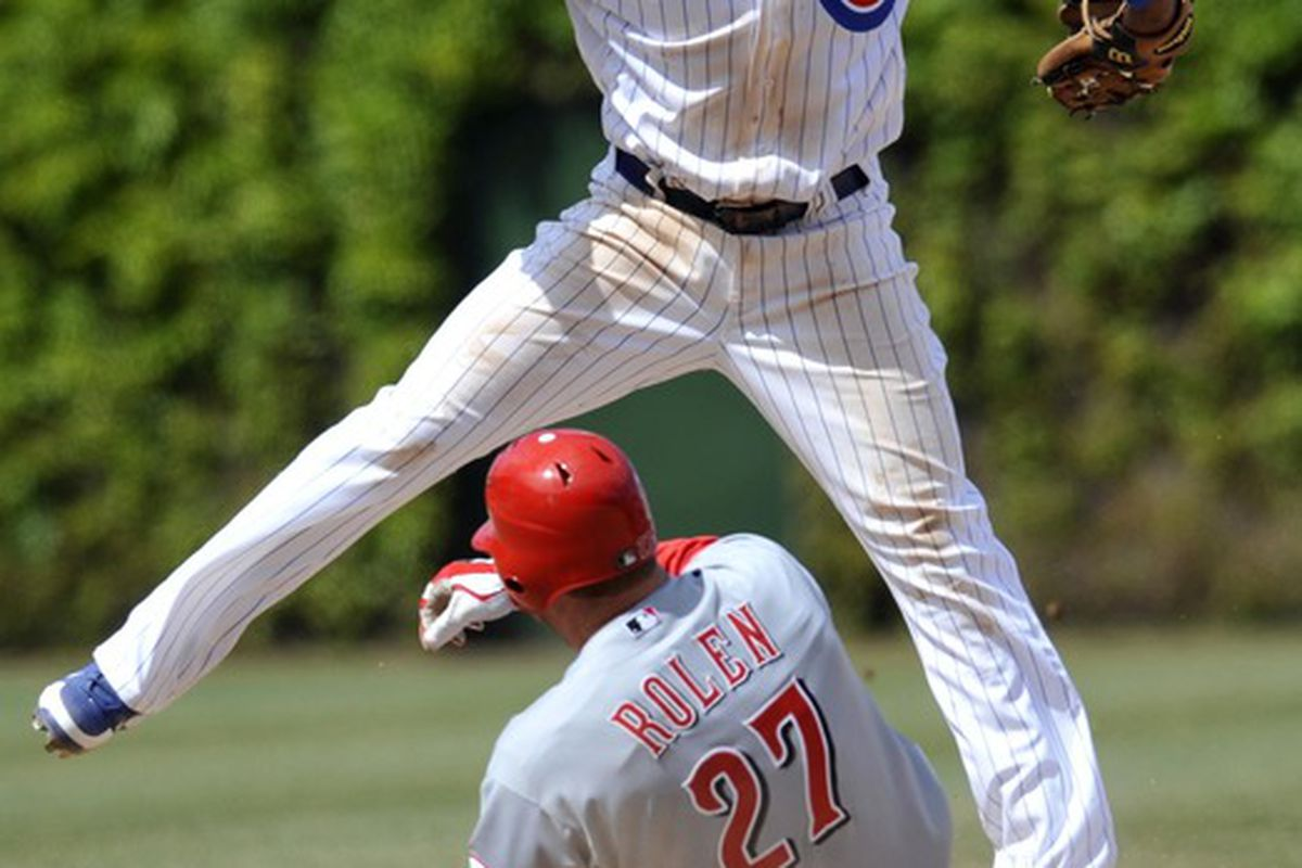 Chicago, IL, USA;  Chicago Cubs shortstop Starlin Castro forces out Cincinnati Reds third baseman Scott Rolen at second base in the eighth inning at Wrigley Field. The Cubs defeated the Reds 6-1. Credit: David Banks-US PRESSWIRE