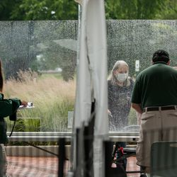 Lincoln Park Zoo staff welcomes a visitor on the first day of Illinois' Phase 4 reopening, Friday afternoon, June 26, 2020.