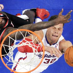 Los Angeles Clippers forward Blake Griffin, right, puts up a shot as Portland Trail Blazers forward J.J. Hickson defends during the first half of their NBA basketball game, Friday, March 30, 2012, in Los Angeles. (AP Photo/Mark J. Terrill)