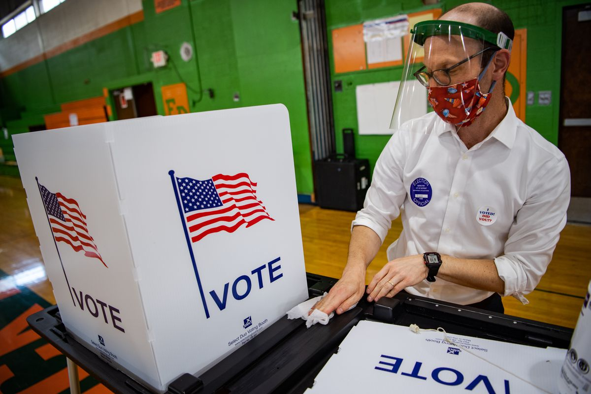 Voters casting ballots at a polling station.