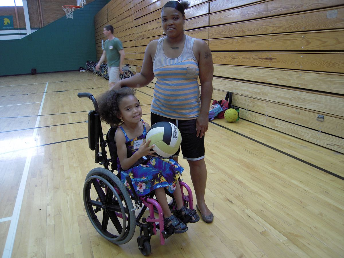 Syndeatra Allen, of Aurora, wants her daughter, Ziar, 7, to have the experience of playing actively with other disabled children.