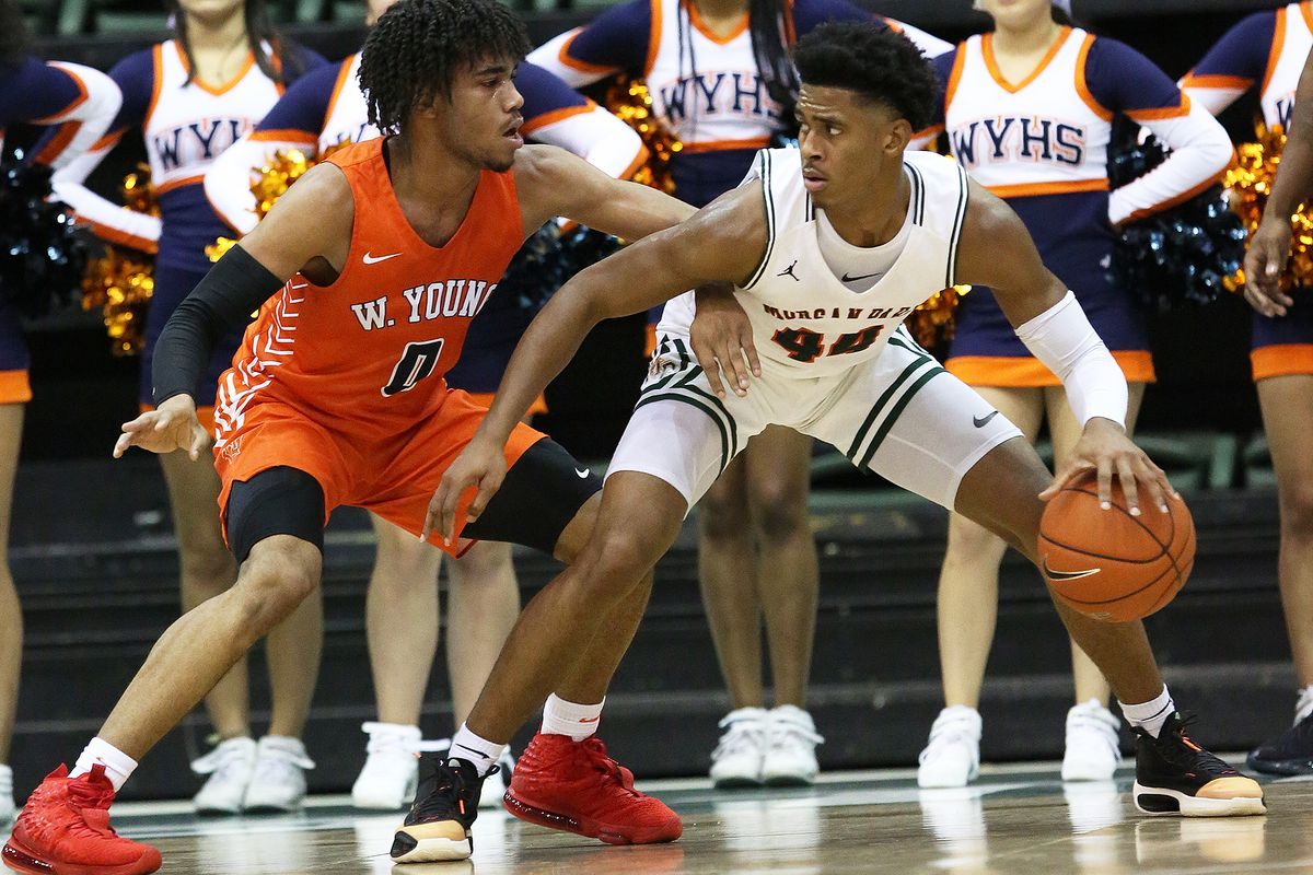 Morgan Park's Adam Miller (44) works the ball down low as Whitney Young's Tyler Beard (0) defends.