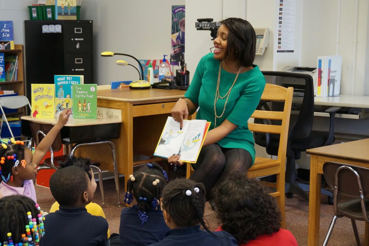 IPS interim Superintendent Aleesia Johnson reading to students at School 48