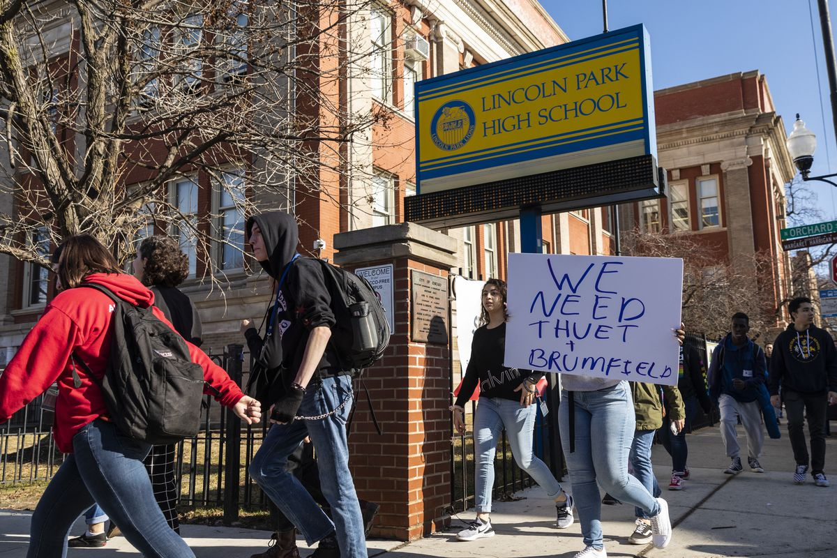 Students stage a protest walkout after Chicago Public Schools fired the interim principal John Thuet and assistant principal Michelle Brumfield, and re-assigned the boys basketball coach Donovan Robinson, due to misconduct allegations at Lincoln Park High School, Monday morning, Feb. 3, 2020. CPS also suspended the varsity boys' basketball team for the rest of the season.