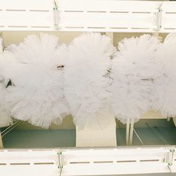Tutus hang from the rafters of the studio ceiling.