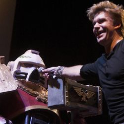 Vic Mignogna jokes around with a Space Marine, played by Jon Robinson, during the Salt Lake Comic Con kickoff news conference at the Salt Palace Convention Center in Salt Lake City, Thursday, Sept. 4, 2014.