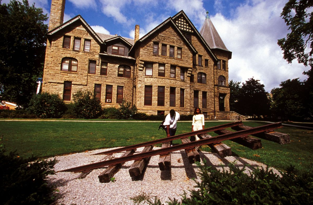 a campus building and an isolated railroad track