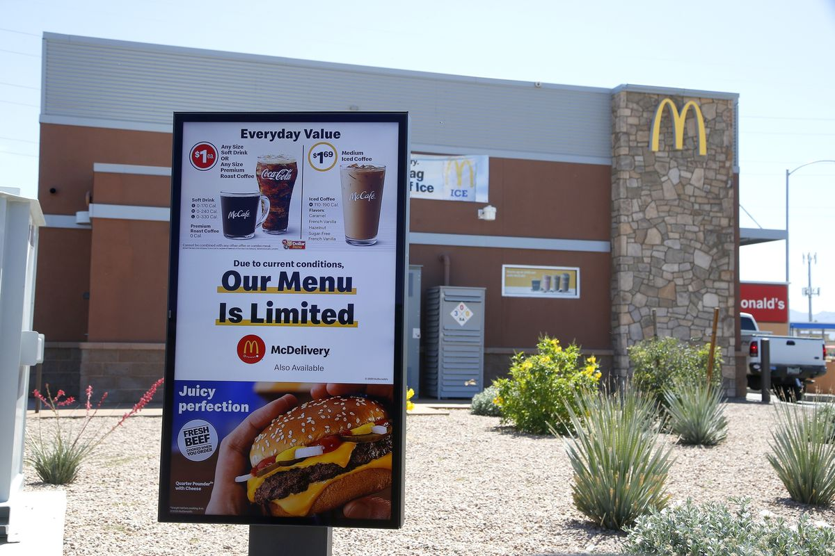 a new sign lets drive-thru customers know that the available menu at a local McDonalds is no longer complete due to the ongoing coronavirus restrictions in Phoenix.