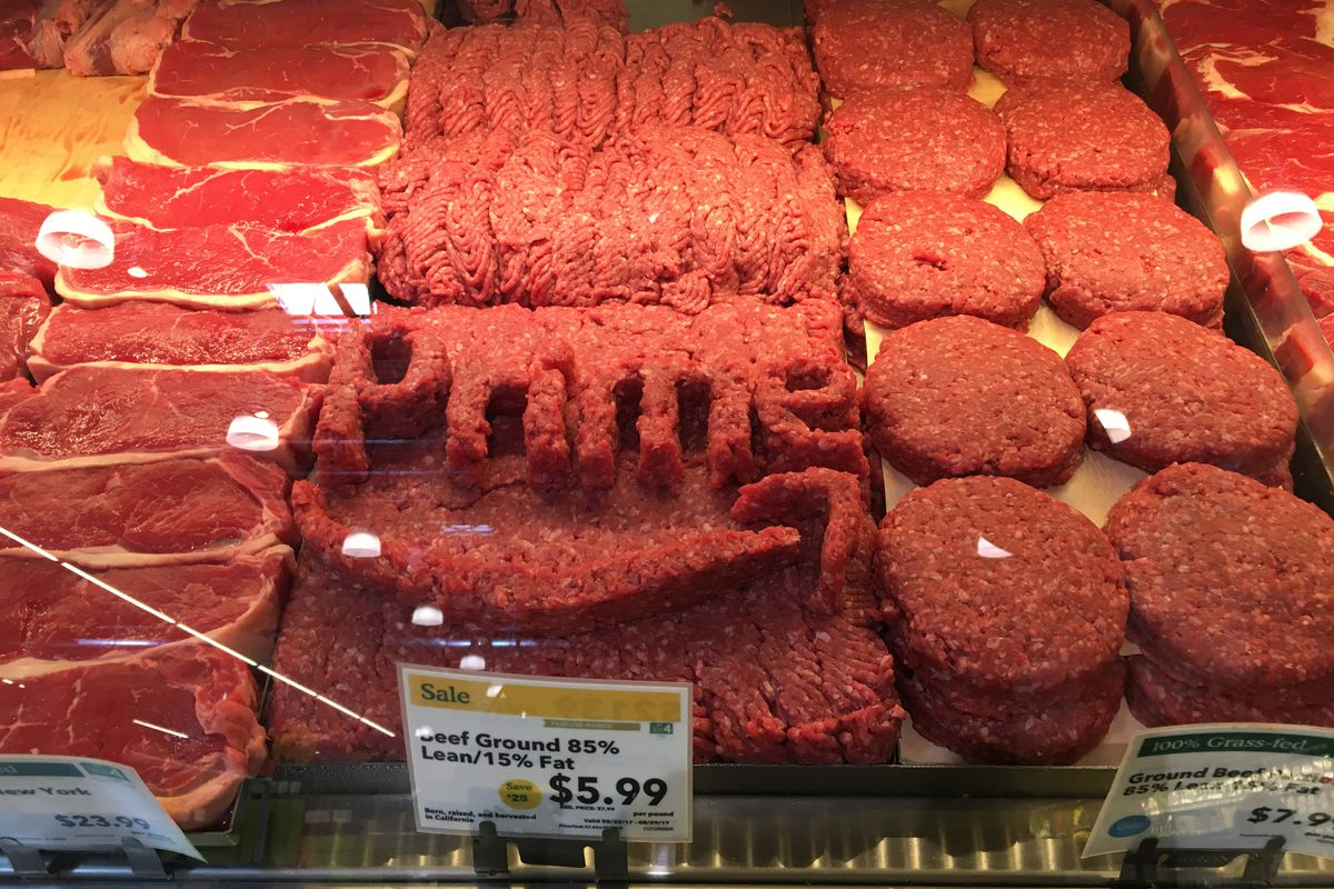 The Amazon Prime logo made out of chopped meat inside a Whole Foods store