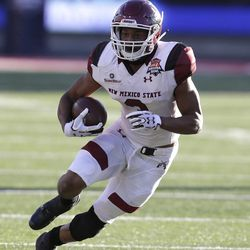 New Mexico State running back Larry Rose III (3) in the first half during an NCAA college football bowl game against Utah State, Friday, Dec. 29, 2017, in Tucson, Ariz. (AP Photo/Rick Scuteri)