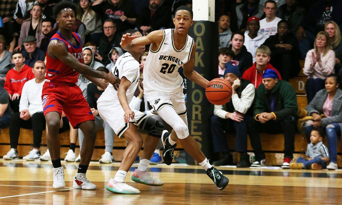 Oak Forest's Jayson Kent (25) drives the baseline toward the basket.