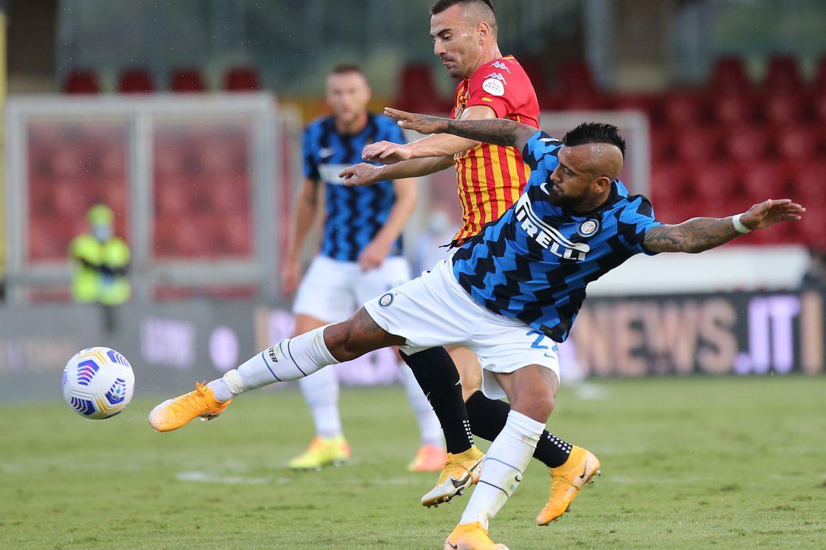 Inter Milan's Chilean midfielder Arturo vidal fights for the...