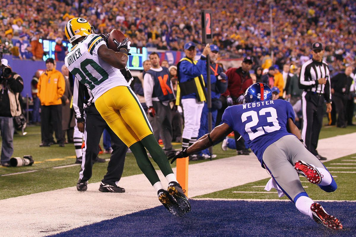 Donald Driver of the Green Bay Packers catches a 7-yard touchdown reception against Corey Webster of the New York Giants in the fourth quarter at MetLife Stadium on December 4, 2011 in East Rutherford, New Jersey.  (Photo by Al Bello/Getty Images)