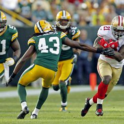 San Francisco 49ers' Frank Gore (21) runs past Green Bay Packers' M.D. Jennings (43) during the second half of an NFL football game Sunday, Sept. 9, 2012, in Green Bay, Wis. The 49ers won 30-22.