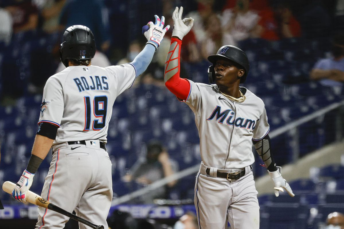Jazz Chisholm Jr. of the Miami Marlins celebrates with teammate Miguel Rojas #19 after hitting a two-run home run during the eighth inning against the Philadelphia Phillies at Citizens Bank Park