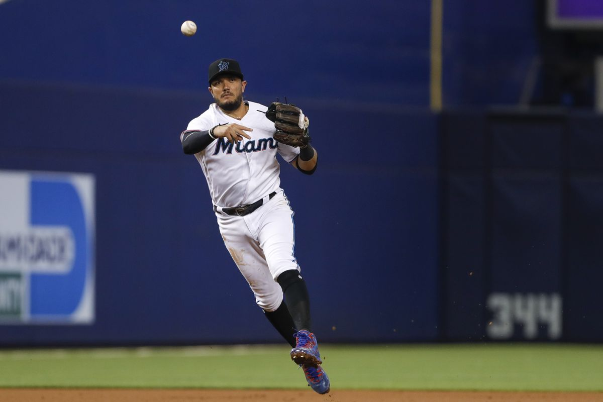 Miami Marlins shortstop Miguel Rojas (19) throws to first base to force out Washington Nationals catcher Yan Gomes (not pictured) during the first inning at loanDepot Park