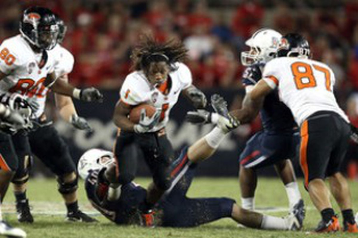 Jacquizz Rodgers (#1) battles for yards in the fourth quarter against Arizona despite having his headgear ripped off.   (Photo by Christian Petersen/Getty Images)