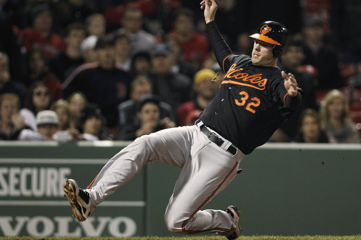 If your belief is strong enough, you can see the feathery white wings spread out behind Matt Wieters as he scores the go-ahead run.  (Photo by Winslow Townson/Getty Images)