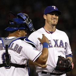 Texas Rangers' Joe Nathan gets a visit from catcher Yorvit Torrealba after giving up a double to Seattle Mariners' Kyle Seager in the ninth inning of a baseball game Wednesday, April 11, 2012, in Arlington, Texas. The Mariners won 4-3.