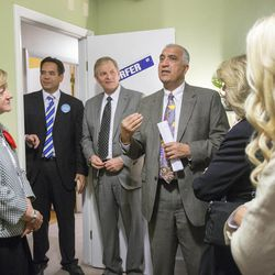 Salt Lake County District Attorney Sim Gill (gesturing), talks with, right to left, Sister Bonnie L. Oscarson, general Young Woman president of the LDS Church, Utah Attorney General Sean Reyes and other LDS leaders during a tour of the Avenues Children's Justice Center Tuesday, April 28, 2015, in Salt Lake City.