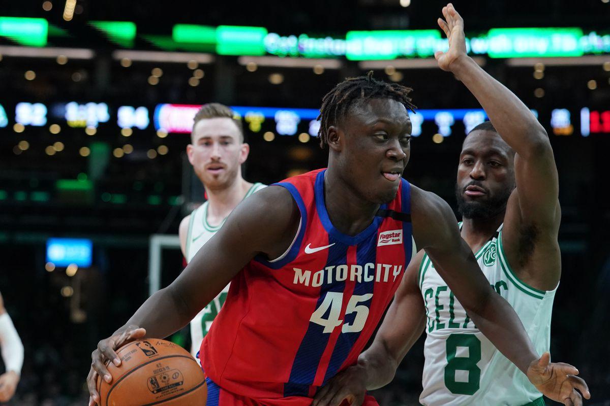 Detroit Pistons forward Sekou Doumbouya drives the ball against Boston Celtics guard Kemba Walker in the second quarter at TD Garden.