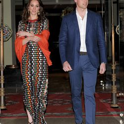 Kate wears a Tory Burch gown before meeting the King and Queen of Bhutan for dinner.
