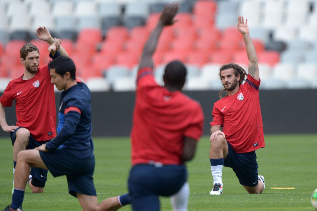 """Kyle Beckerman waits patiently for Jurgen Klinsmann to answer his question: """"Can we have a qualifier at Rio Tinto? I promise it will sell out."""""""