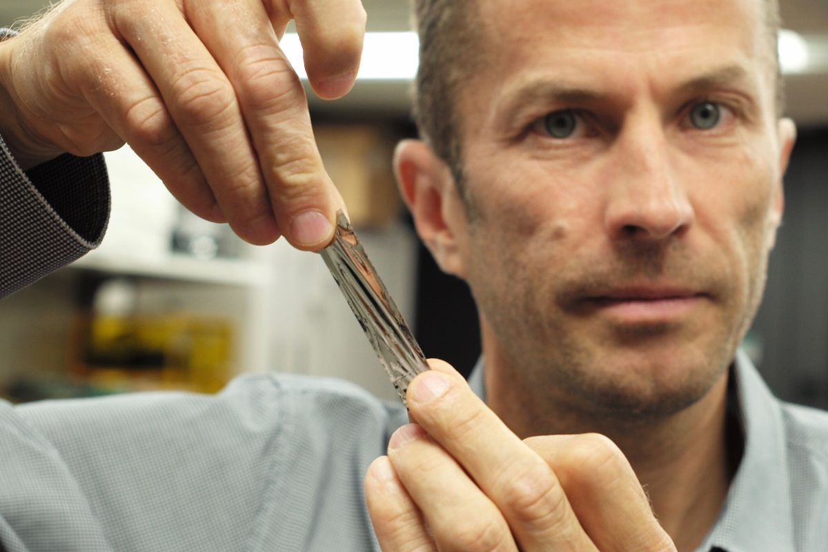 IBM scientist Dr. Mark Lantz holds a one square inch piece of sputtered tape which can hold 201 Gigabytes a new world record