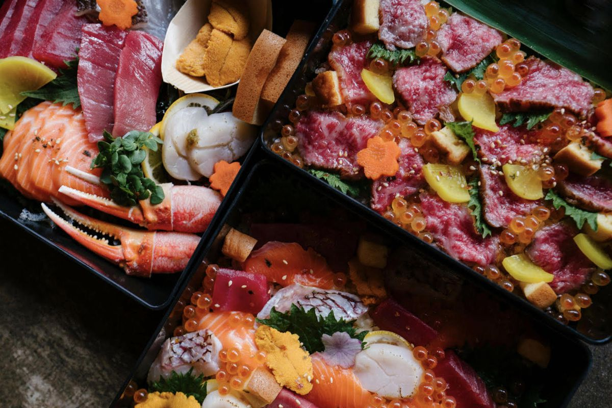 An overhead triptych of bento/chirashi boxes in dim lighting.