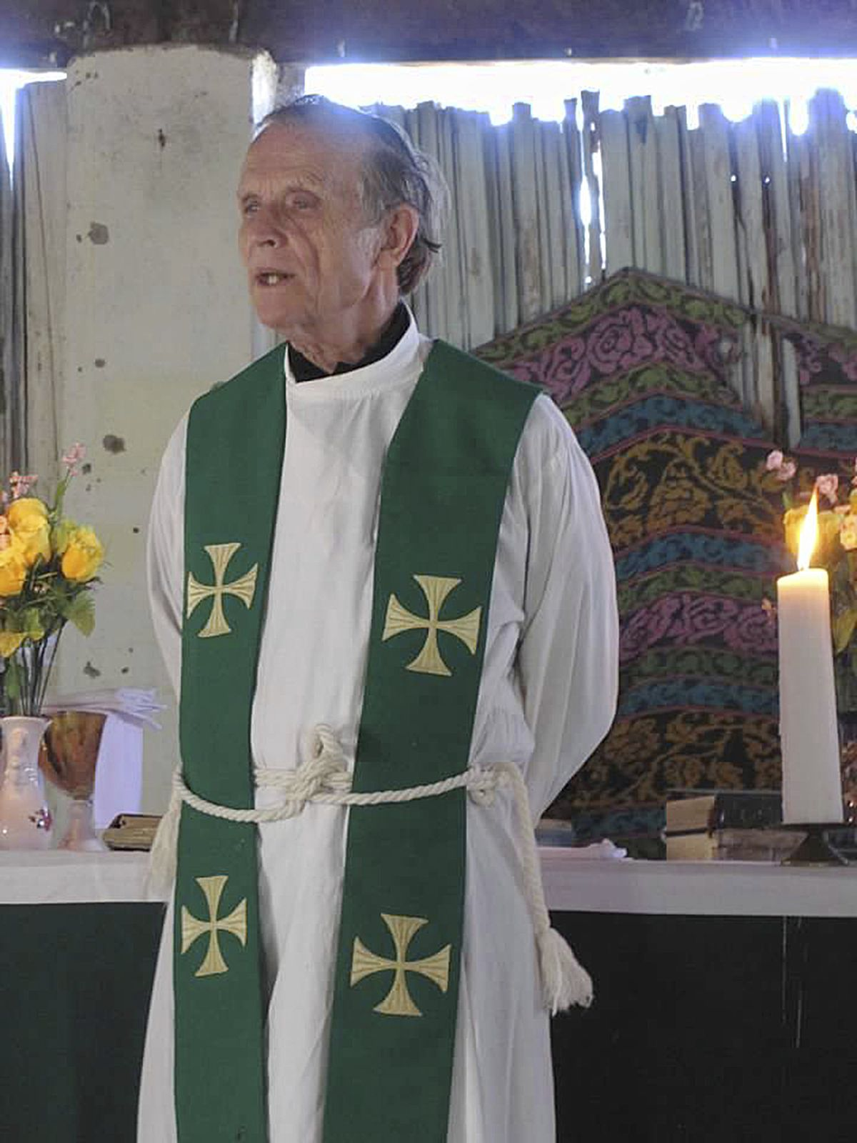 This 2013 photo provided to The Associated Press shows now-defrocked Catholic priest Richard Daschbach leading a service at a church in Kutet, East Timor.