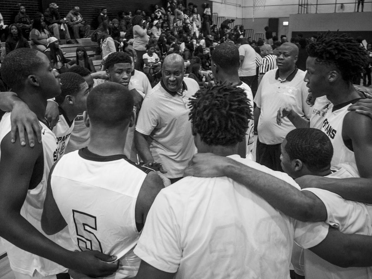 Players on the Orr Academy High School basketball team get fired up during a timeout against North Lawndale College Prep High School, Jan. 13, 2017.