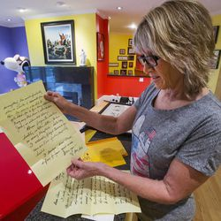 Amy Schulz Johnson, daughter of Peanuts' creator Charles Schulz, shows a letter she received from her father while she was serving an LDS mission in England. Johnson talked about her father during an interview at her home in Alpine on Wednesday, Oct. 28, 2015.