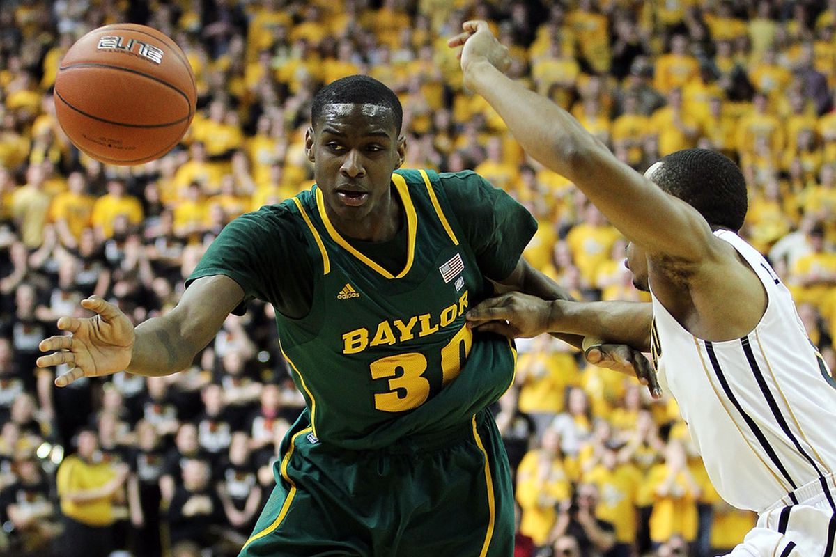 COLUMBIA, MO - FEBRUARY 11:  Quincy Acy #30 of the Baylor Bears loses the ball as Matt Pressey #3 of the Missouri Tigers defends during the game on February 11, 2012  at Mizzou Arena in Columbia, Missouri.  (Photo by Jamie Squire/Getty Images)