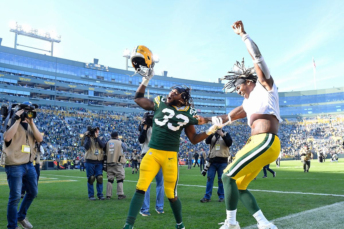 Aaron Jones #33 of the Green Bay Packers and Jamaal Williams #30 of the Green Bay Packers celebrate after the game against the Oakland Raiders at Lambeau Field on October 20, 2019 in Green Bay, Wisconsin.